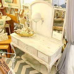Sweet rustic white shabby chic locking vanity in my booth @curiositiesvintage  What would you do with that open middle space?