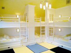 Kids guest bedroom bunk room it the Bridgehampton house of Hamptons builder Joe Farrell