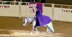 Laura Sumrall captivated the crowd winning the World Freestyle title at the Kentucky Reining Cup. She came riding out in a beautiful cape, and as she removed it, wearing a sparkling blue gown resembling that of Elsa's dress from the movie Frozen. Laura and her horse performed a beaut..