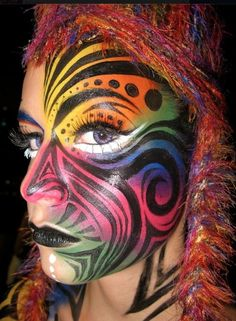 colourful rainbow tribal design #snazaroo #facepainting | See more about Color Me Beautiful, Tribal Designs and Bright Colours.