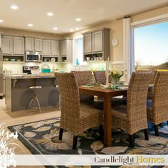 www.CandlelightHomes.com, kitchen, dining area, grey kitchen countertops, can lights, can lighting, hardwood floors, wood flooring, wooden floors, wicker dining chairs, area rug, silver barstools, dining set, Candlelight Homes