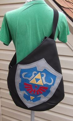 22d8bd7228f5 Legend of Zelda Inspired Hylian Shield Symbol Sling Backpack Knights of  Hyrule by KraftyNerdSquad on Etsy