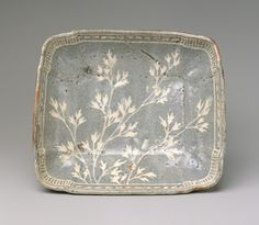 Dish with design of grasses, Momoyama period (1573–1615), late 16th–early 17th century  Japan  Stoneware with decoration incised through iron-rich clay slip (Mino ware, gray Shino type)
