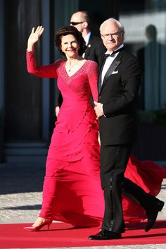 Queen Silvia was the epitome of elegance in a floor-sweeping red gown that showed off her slim physique to perfection.