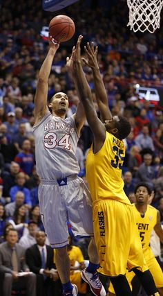 Kansas forward Perry Ellis (34) turns for a shot over Kent State forward Jimmy Hall (35) during the first half on Tuesday, Dec. 30, 2014 at Allen Fieldhouse. #KU