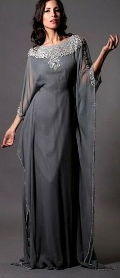 Crystal Stone Kaftan Dresses (Nisaa Boutique) - A one of a kind grey sapphire colour with embroidered neck and sleeves along the piping. The kaftan comes with adjustable ties at waistline and is fully lined. Modest Fashion, Hijab Fashion, Arabic Dress, Kaftan Style, Moroccan Dress, Mode Style, African Fashion, Designer Dresses, Beautiful Dresses