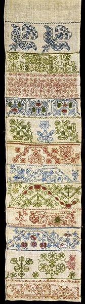 English Sampler (Top half of sampler) ~ middle of 17th century ~ V&A Museum, London ~ This is a band sampler. This unfinished example is one of a type that combines repeating patterns worked in coloured silks with areas of cutwork (holes that are cut and then bound by stitches) and needle lace stitches, working from either end towards the middle.