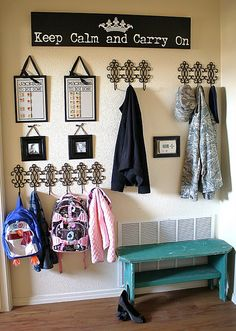 I love this idea...though its a little too moderm for my taste...put up spme rustic hooks and frames and rustic up the sign a bit would be great fo rmy country decorated home =)