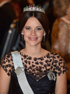 Princess Sofia, a former bikini model who reportedly caused somewhat of a stir when first introduced to the royal family, wore a dark gown with floral 3D detailing, topped by her delicate emerald and diamond tiara which was designed for her wedding day