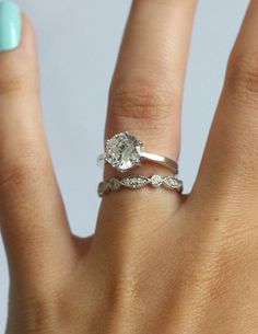 Simple solitaire engagement ring with stunning vintage band!  Love!