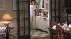 "Kathleen's (Meg Ryan) cute New York apartment in ""You've Got Mail"". Love that kitchen floor & the doors!"