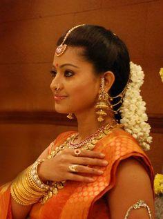 South Indian bride. Temple jewelry. Jhumkis.Red silk kanchipuram sari.Braid with fresh flowers. Tamil bride. Telugu bride. Kannada bride. Hindu bride. Malayalee bride.Kerala bride.South Indian wedding.Sneha