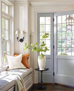 Foyer with large windows and neutral colors