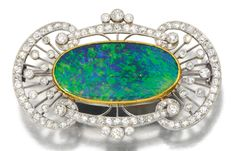 Ostentatious, No, Just an Opulent Opal Centered in a Beautiful Brooch with Gold, Diamonds and Platinum, 1910.