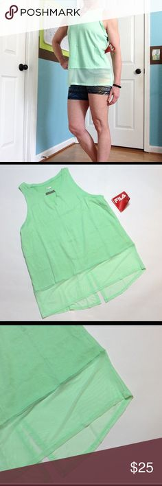 """Fila Glam sheer bottom singlet Almost too pretty to just workout in! ☺️ Hi lo tank w/ keyhole neckline, has split seam in the back. Length 25-26"""", bust 20"""" pit to pit. Fila Tops Tank Tops"""