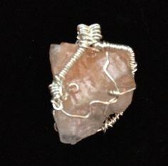 Coral Calcite wire wrap pendant on etsy.com by The Crystal Pyramid $9.99