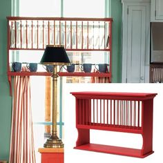 colorful cottage kitchen with red painted plate rack