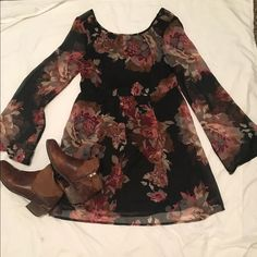 ✨NWOT Flower boho dress Very cute black dress with maroon flowers. Could wear with boots and a black hat. Arms are see throughout and the back sits lower than the front . Never worn. Purchased at urban outfitters. Staring at stars brand. Last picture is just how it should fit, it is not the dress. Urban Outfitters Dresses Long Sleeve