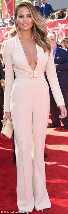 Chrissy Teigen donned a plunging pale pink jumpsuit for the 2014 ESPYS http://dailym.ai/1qijDDm