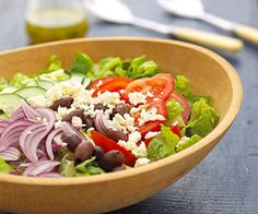 For a quick vibrant salad, make the Greek vinaigrette ahead of time and store it in the fridge so it will be ready to toss with greens, olives and feta cheese.