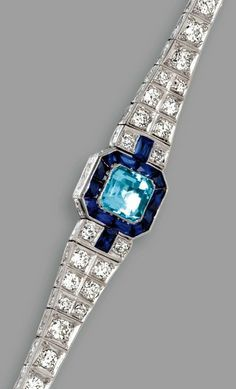 PLATINUM, AQUAMARINE, SAPPHIRE AND DIAMOND BRACELET, CIRCA 1925