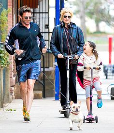 Hugh Jackman and the family dog jogged while wife Debora-Lee Furniss and daughter Ava moved via scooters in NYC April 10.