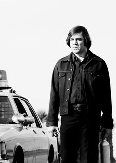 Javier Bardem as hitman Anton Chigurh in No Country For Old Men. I could watch this movie on a loopso good.