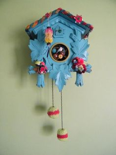 Makeover magic: Reclaimed cuckoo clock by bloomsburyloft. By using paint, bits of sweaters, fabric, vintage buttons, ornaments, enamel flowers, and a pretty bird, this upcycled cuckoo clock gets a charming makeover.
