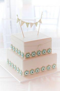 wedding whimsical cakes | whimsical-wedding-cake-with-bunting-cake-topper