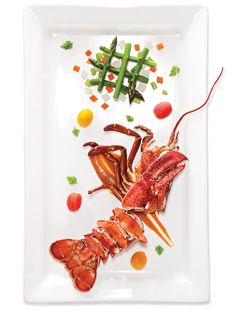 The tomato-wine sauce for this light lobster dish, adapted from French chef Michel Guérard's diet-based cookbook, Cuisine Minceur (William Morrow, 1986), gets depth of flavor from the addition of the lobster's tomalley.