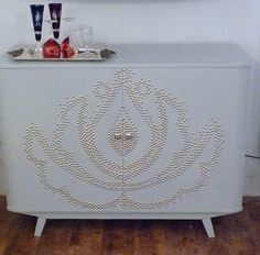 DIY Cabinet with upholstery tacks and Hungarian motif. Awesome!
