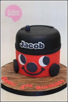 Henry Hoover 3D birthday cake, hand carved with a wood effect cake board. x
