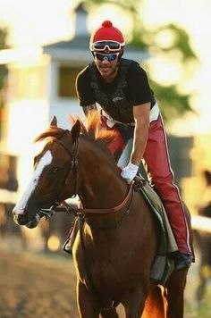 California Chrome and exercise rider Willie Delgado