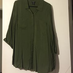 Three quarter sleeve blouse Three quarter sleeve Torrid Blouse. Army green. Great fit never worn but tags removed. torrid Tops Button Down Shirts