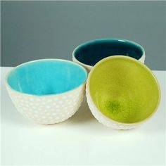Entertain in style with this petite trio of wheel-thrown ceramic bowls with glossy-white raised spots dotting their creamy stoneware exteriors. The interiors are a striking combination of glossy, crackled acid yellow-green, Argentine blue, and peacock/cerulean blue. Lovely for hors d'oevres and perfect for gifting. $66