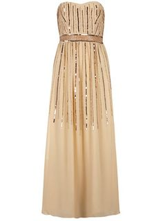 This cream maxi dress with featured rose gold embellishment perfect for an occasion