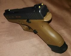 Glock 42 with Truglo TFO night sights yellow rear green front Find our speedloader now!  www.raeind.com  or  http://www.amazon.com/shops/raeind