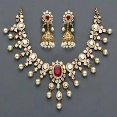 Necklace and earrings, India style, of diamonds, pearls, and rubies.