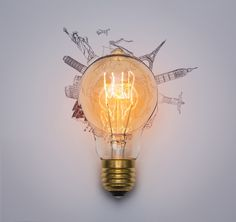 Light bulb with monuments drawn around Free Photo