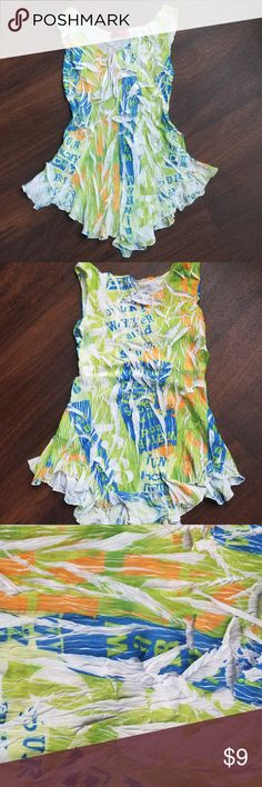 Carina Sleeveless Tank Size Small In excellent condition.  This colorful tank is stretchy.  Colors are green, orange, blue, and white.  It' a bit sheer.  The size tag is missing.  I measured from pit to pit at 32 inches.  100% polyester.  Hand wash, dry flat. Carina Tops Tank Tops