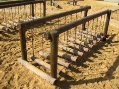 Playground bridge: Playground at midday. Shots of the wooden bridge.These are very nice fixtures theyve provided around for kids here, to be sure. Plenty of wood and friendly warm colors, look great especially in summer sunlight.:
