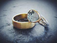 Blue topaz wedding ring in 14k yellow and 18k white gold. Men's wide wedding band in 14K yellow gold with satin finish. Handmade Artisan Jewelry by Erica Freestone in Pacific Grove, CA