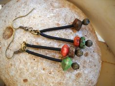 Boho Style Antique Brass with Multi-Color Wood Beads and Black Tubing Earrings by Beads4You2008 on Etsy https://www.etsy.com/listing/239079427/boho-style-antique-brass-with-multi