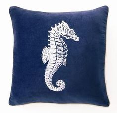 D.L. Rhein's collection of luxurious coastal style velvet pillows featuring iconic ocean images. Deep blue velvet accent pillow with hand embroidered detail featuring a large sea horse centered on the
