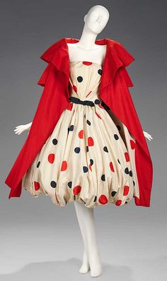 Arnold Scaasi 1961.  A cream silk satin dress printed with red and black polka dots with red barathea.  One of my favs ;-)