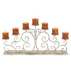 Scrolling iron candelabra in distressed white.  Product: CandelabraConstruction Material: MetalColor...