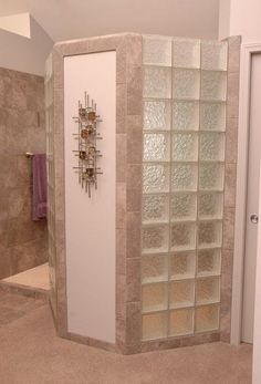 doorless walk in shower with block glass privacy wall by neals design remodel