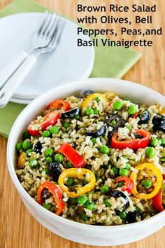 I made this and took it in a family camping trip. So yummy. {Brown Rice Salad Recipe with Olives, Bell Peppers, Peas, and Basil Vinaigrette is a perfect dish to take to a summer pot-luck. [from Kalyn's Kitchen] #GlutenFree #SummerFood}