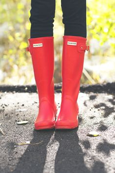 It's the rainy time of  year. I love these bright red rain boots. #fashion