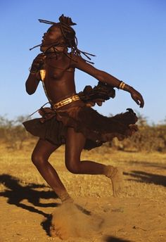 Spinning Himba Dancer by Carol Beckwith and Angela Fisher ~ The whirling Ondjongo dance marks the climax of a Himba marriage ceremony.